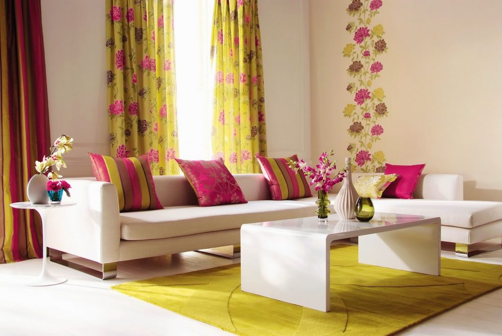 The colorful curtains and rugs